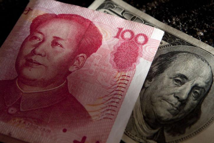China va permite o convertibilitate limitată a yuanului în trei zone comerciale libere